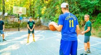 Boys play basketball at summer camp