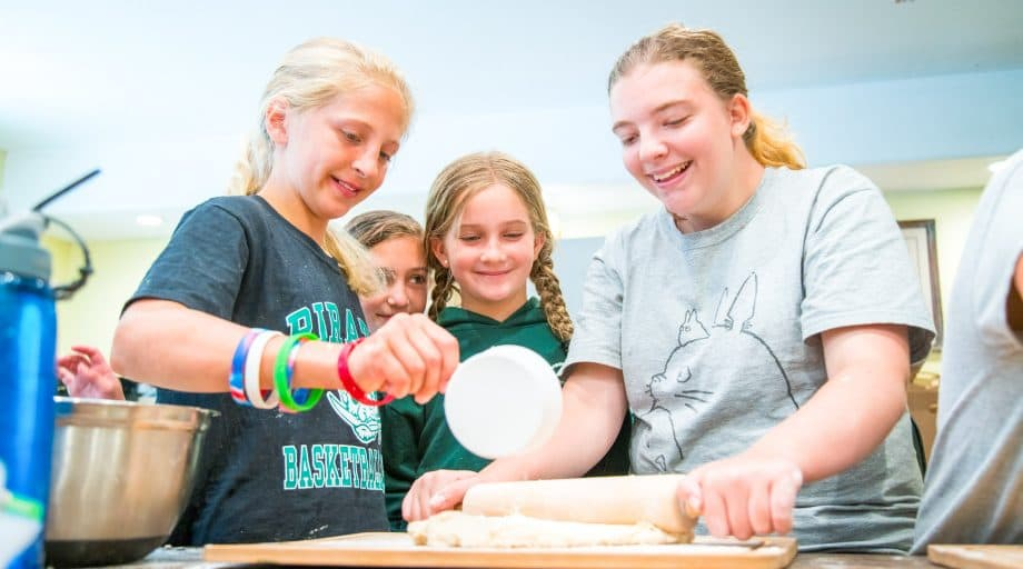 Campers make dough at summer camp