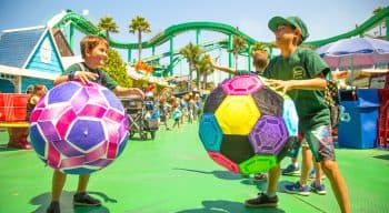 campers playing with large soccerballs on the boardwalk