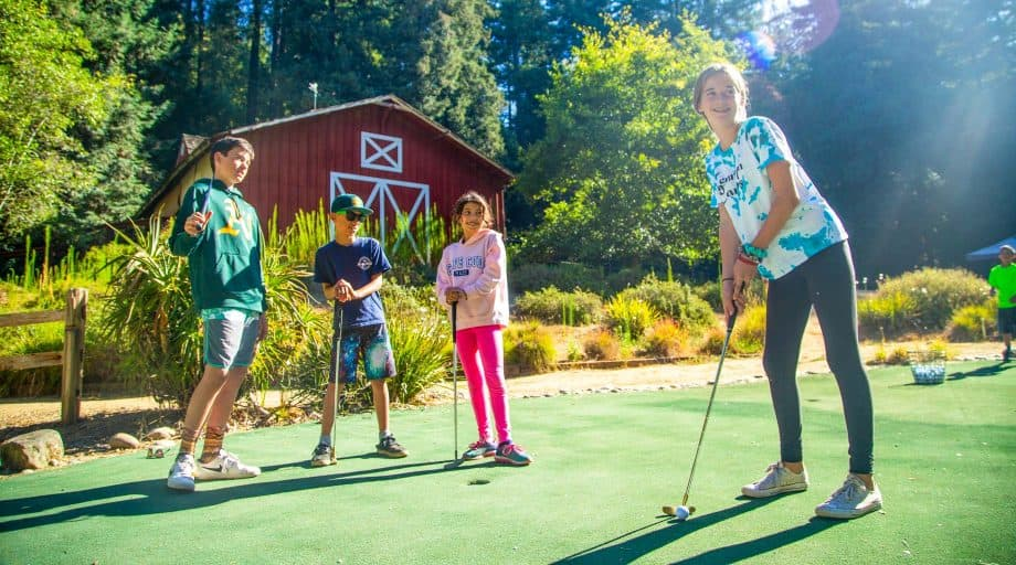 Group of campers golfing at summer camp