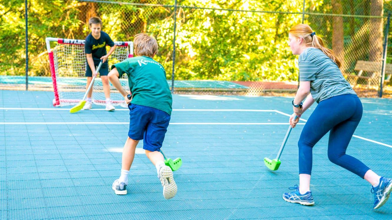 Summer campers play street hockey