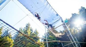 Campers swinging on a trapeze