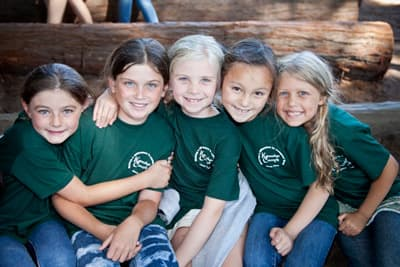 Five campers smiling for a photo