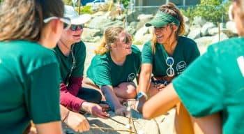 Counselors on the beach roasting marshmallows
