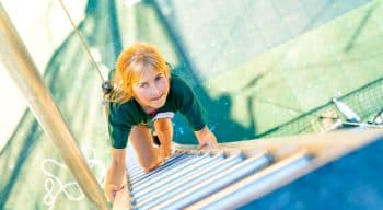 Aerial view of a girl climbing a ladder