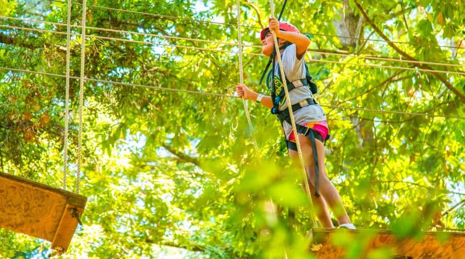 A girl walking the plank on the ropes course