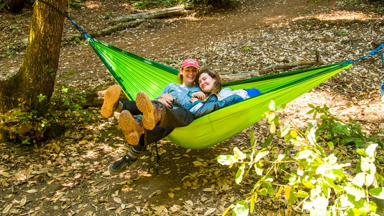 Girls lounging in hammock at summer camp