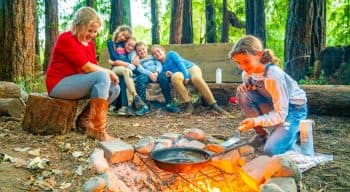 Camping group does outdoor cooking