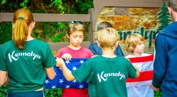 Campers folding the american flag