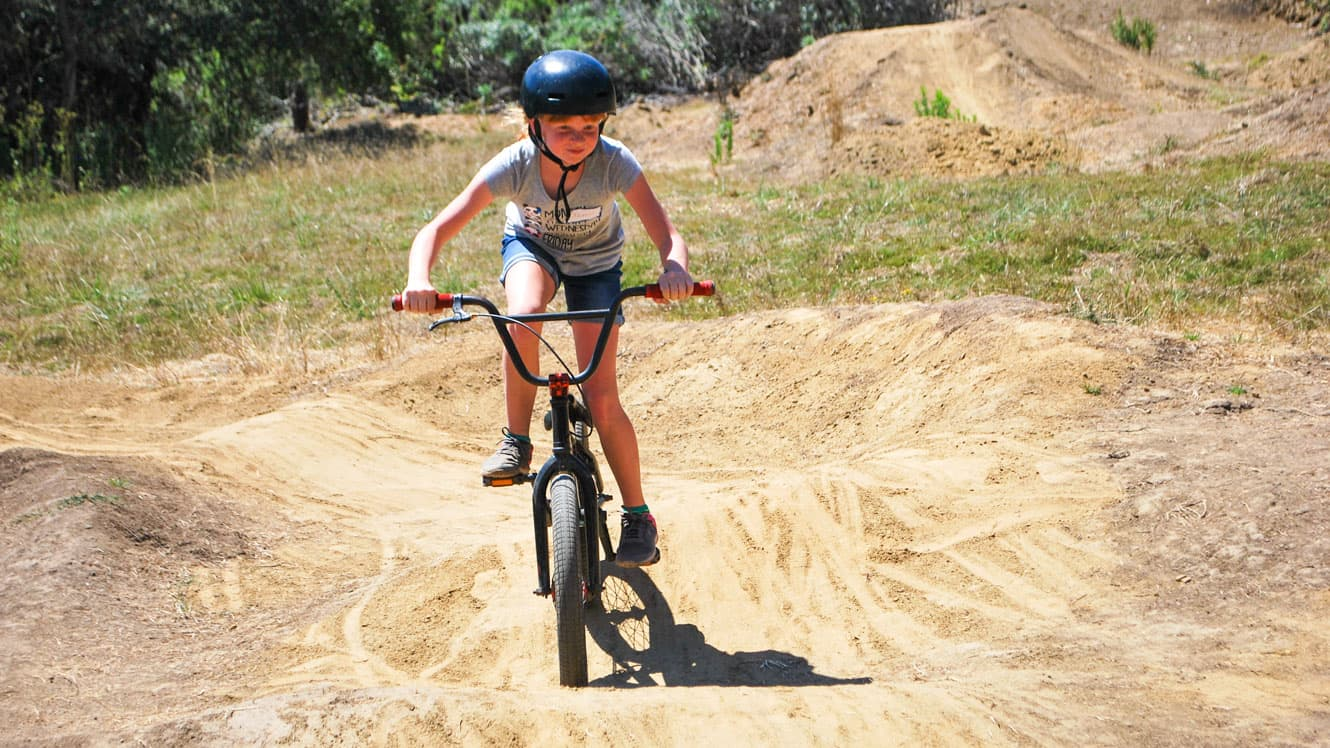 Kennolyn day camper rides BMX bike