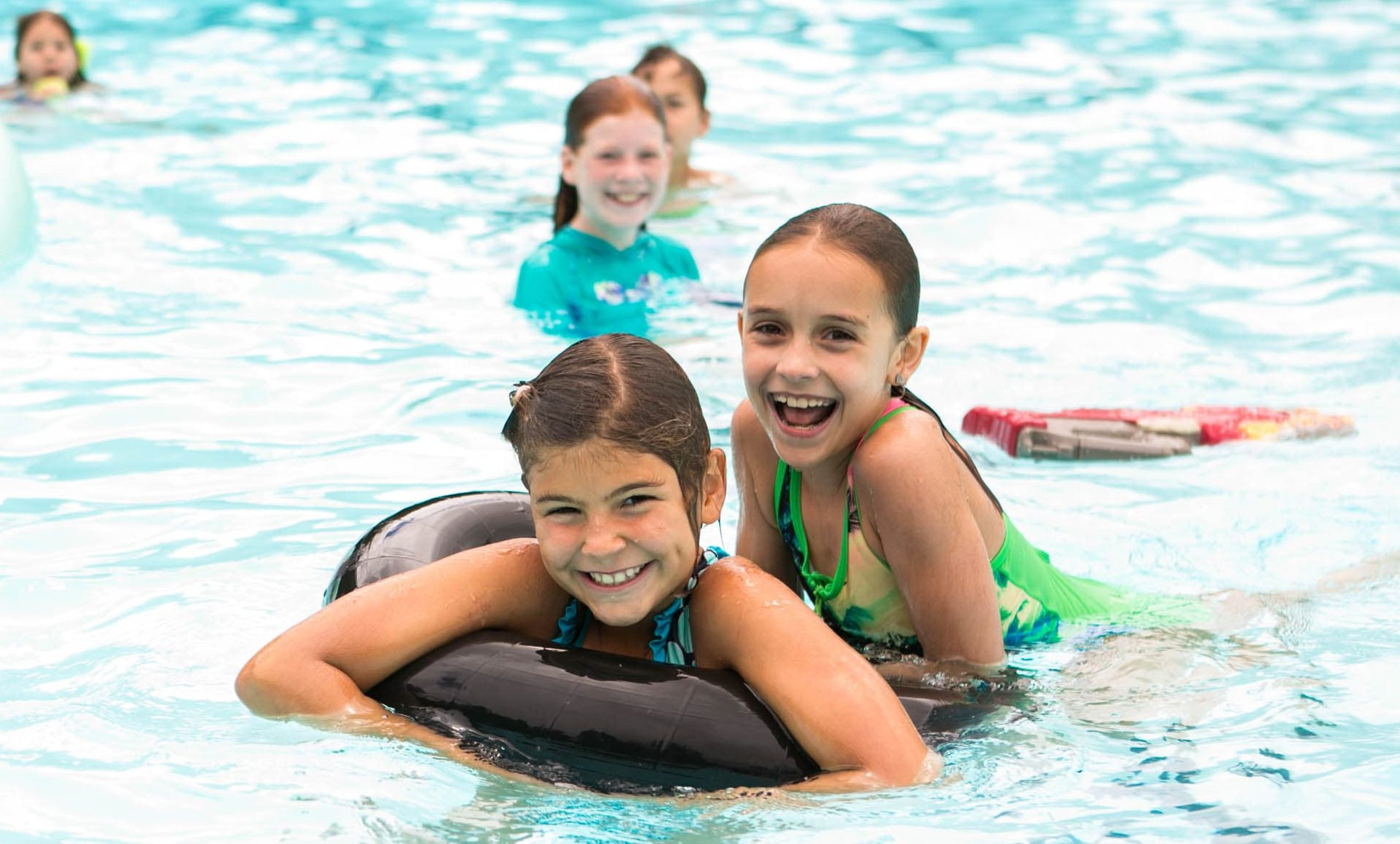 Kennolyn day campers laugh while swimming