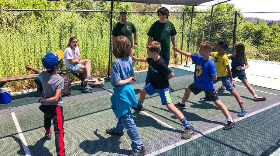 Day campers practice fencing