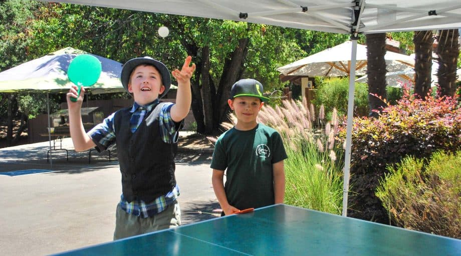 Day campers play ping pong