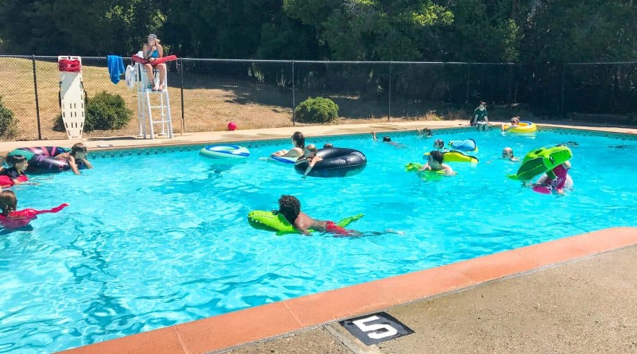 Day campers swim in heated outdoor pool
