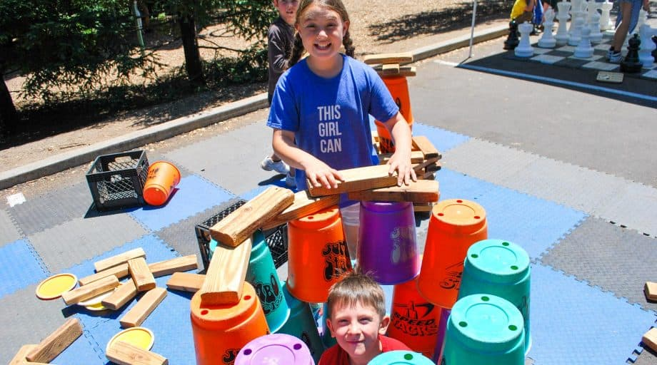 Day campers stack giant cups