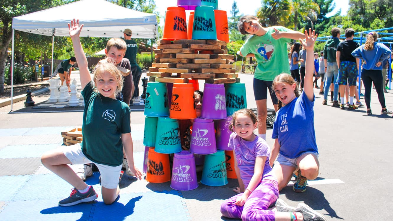 Day campers pose in front of stacked buckets