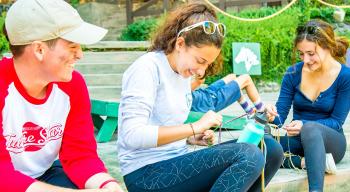 Campers making friendship bracelets