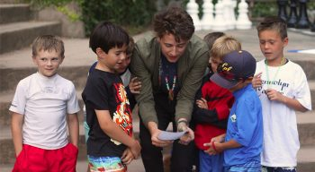 A counselor reading a clue to campers