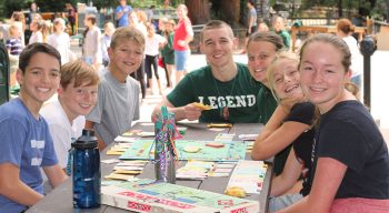 Campers and counselors playing board games