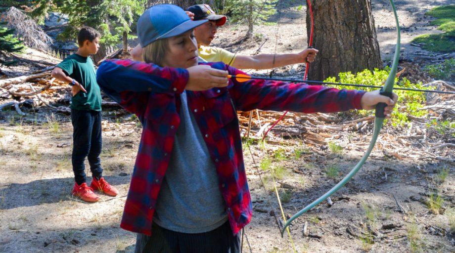 A boy shooting an arrow
