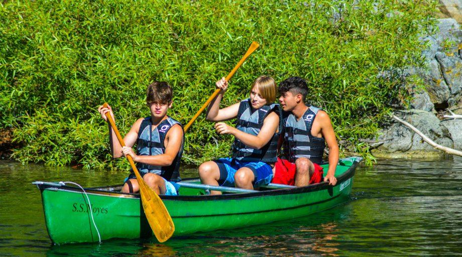 Boys on a canoe