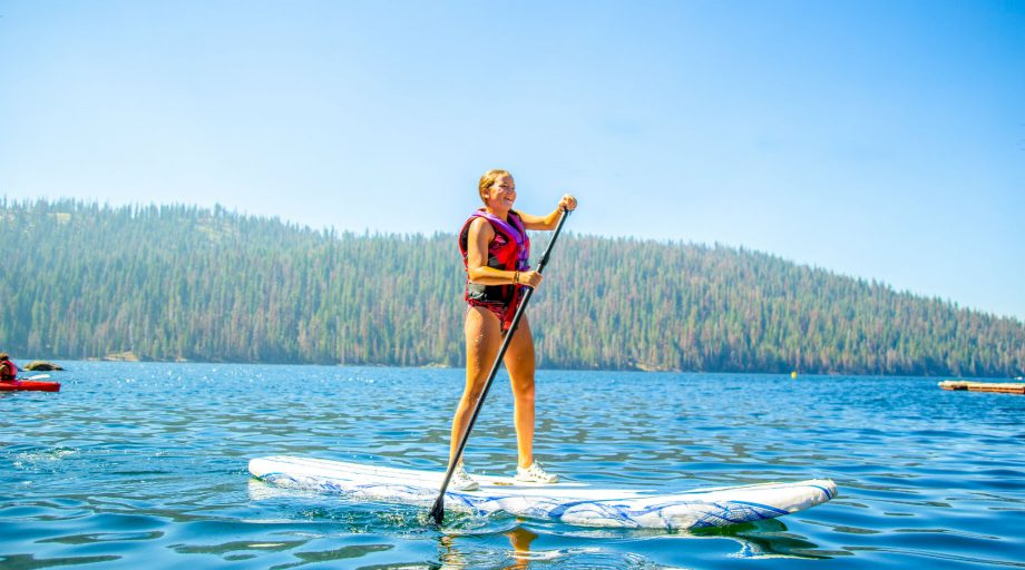a girl paddleboarding