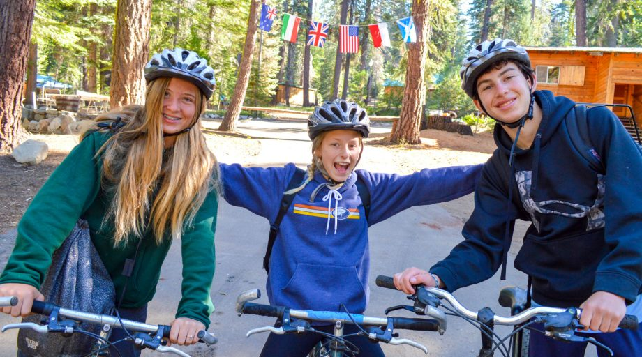 Campers riding bikes pose for a photo together