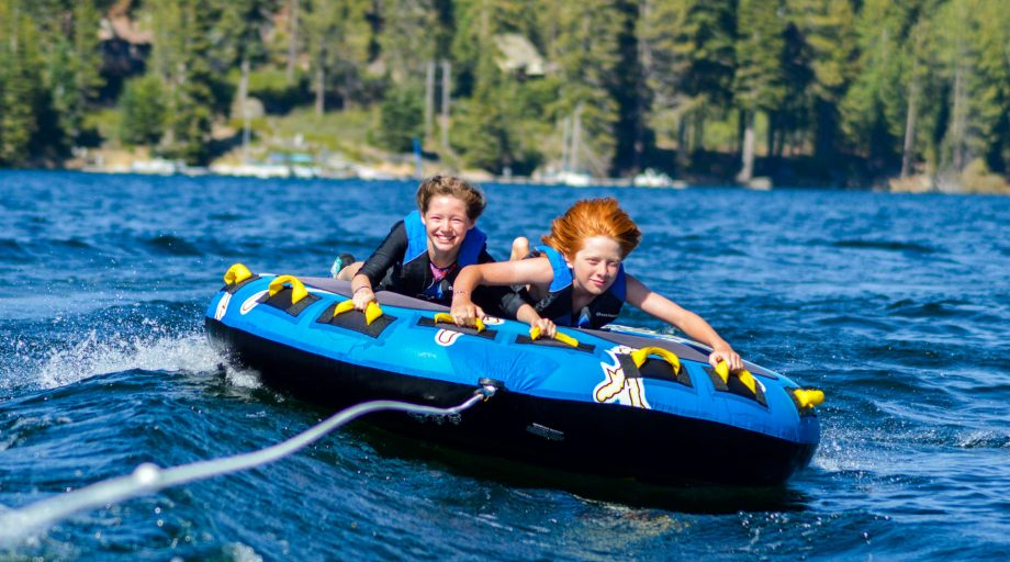 two kids on a water tube