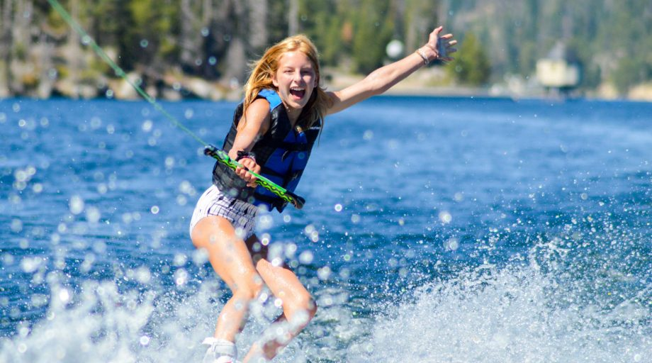 A girl trying a trick on water skis